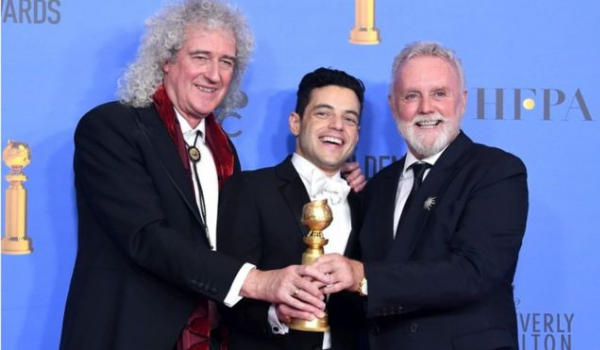 Brian May, o ator Rami Malek e Roger Taylor | Foto: Kevin Winter/Getty Images